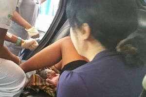Medical staff at SGH cut the baby's umbilical cord in the car.