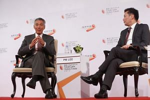 Prime Minister Lee Hsien Loong speaking at the dialogue, moderated by Lianhe Zaobao editor Goh Sin Teck, at the FutureChina Global Forum.