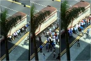 Passers-by helping to lift a truck to free a man pinned underneath. The 35-year-old South Korean who was pinned under a truck on Wednesday is recovering at Tan Tock Seng Hospital.
