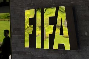 US regulators are probing large banks over their possible handling of tainted funds in the Fifa corruption scandal.