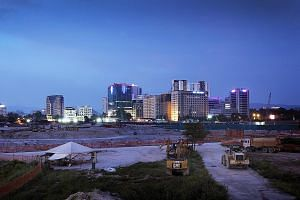 Construction machinery at the site of the Tun Razak Exchange project developed by 1Malaysia Development Berhad. The project is named after Prime Minister Najib Razak's father, Tun Razak Hussein, who was the second prime minister of Malaysia.