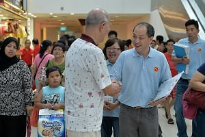 Workers' Party chief Low Thia Khiang speaking to a shopper at Rivervale Plaza during a walkabout yesterday. He said the party would return to areas they have contested before. This means the WP will field 28 candidates in the next general election -