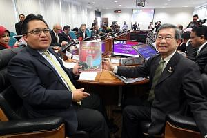 Public Accounts Committee chairman Nur Jazlan Mohamed (far left) and his deputy Tan Seng Giaw with an interim report on 1MDB in a file photo. Replacements for committee members newly appointed to the Cabinet must be found.