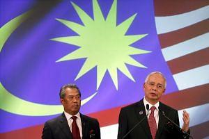 Malaysian PM Najib Razak (right) and his deputy Muhyiddin Yassin in a 2013 photo.