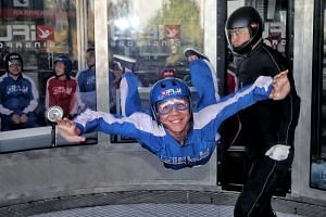 Trying to contort one's body in an aerodynamic fashion while flailing in mid-air proved tricky at Sentosa's iFly Singapore.