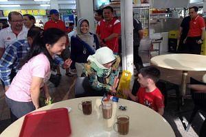 Jurong GRC MP Halimah Yacob meeting residents in Bukit Batok East, along with Ms Rahayu Mahzam (behind her).