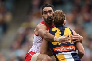 Adam Goodes (left) of the Sydney Swans tackling Mark Hutchings of the West Coast Eagles in an AFL game at Domain Stadium, Perth, on July 26. Goodes, a leading Aboriginal star, has faced abuse by fans.