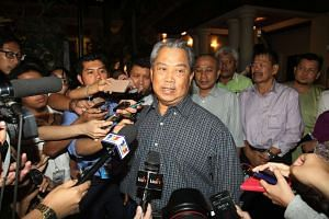 Malaysia's former Deputy Prime Minister Tan Sri Muhyiddin Yassin meeting the media in front of his house at Damansara Height in Kuala Lumpur on July 28, 2015.