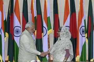 Indian Prime Minister Narendra Modi (left) shakes hand with Bangladeshi Prime Minister Sheikh Hasina Wajid (right) on June 6, 2015.