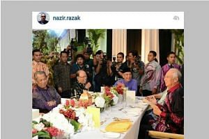 A picture posted by Malaysian banker Nazir Razak showing Malaysian Prime Minister Najib Razak's (right)