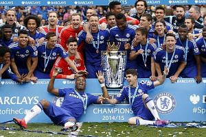 Chelsea celebrating with the Premier League trophy in May. They will aim to become the first side to win back-to-back titles since Manchester United's hat-trick from 2007-09.