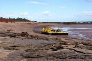 A hovercraft is the only sign of modernity on a beach filled with some of the world's best-preserved prehistoric fossils at Australia's isolated north-west coast.