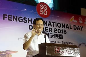 Raymond Lim gives a speech at the Fengshan National Day Dinner, held at Fengshan Community Club on Sunday, Aug 2, 2015.