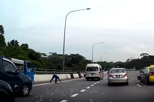 Motorists picking up the notes on the BKE.