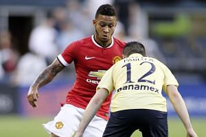 Memphis Depay on the ball against Pablo Cesar Aguilar of Club America during a pre-season friendly. United's new £25 million Dutch winger can also play as an attacking midfielder or second striker.