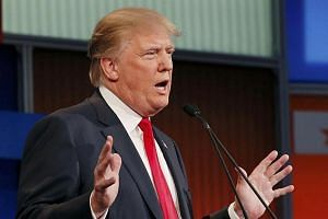 Donald Trump answering a question at the first official Republican presidential candidates debate.