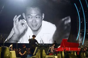 As the orchestra played the mournful second movement, Elegy, pictures of the late Mr Lee Kuan Yew (above) unfolded on a giant screen.