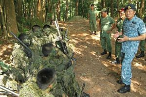 Chief of Defence Force Ng Chee Meng speaking to commandos during a training session last year. He will retire from the SAF on Aug 18.