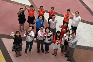 After 12 teddy bears made by Juying Secondary School students were sold for charity, teachers and staff members banded together to make another 18 bears for sale. (Back row, from left) Administrative assistant Wendy Chia, who is a member of the schoo