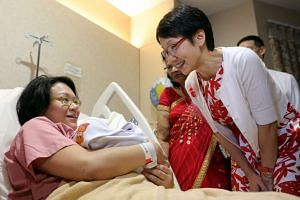 Ms Angeline Lim, with her jubilee baby boy Ryker Jedd Ng, speaking to Minister in the Prime Minister's Office Grace Fu (right), who visited the family at KK Women's and Children's Hospital (KKH) on Aug 9, 2015. Ms Lim gave birth to her son at t