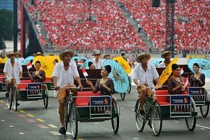 SIA girls on trishaws during the National Day Parade 2015.