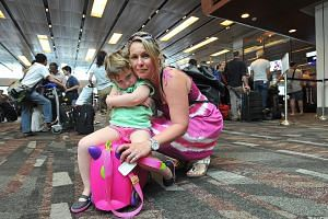 Australian housewife Melanie Dobson, 42, and her daughter Trinity, four, were among the Qantas passengers whose flight from Singapore to Melbourne was delayed on Sunday.
