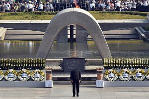 Japanese Premier Shinzo Abe bowing at the memorial for victims of the 1945 atomic bombing at a ceremony in Hiroshima to mark its 70th anniversary last Thursday. The wounds of World War II linger in Asia because of Japan's inability to integrate with