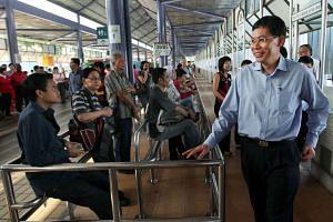 Mr Lui Tuck Yew touring Yishun Bus Interchange on Aug 13, 2012.