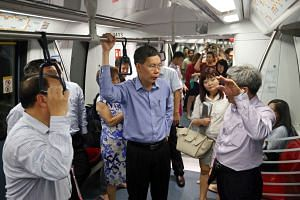 Mr Lui Tuck Yew riding one of the new trains on the Circle Line on Aug 3, 2015.