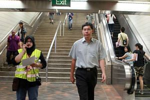 Mr Lui Tuck Yew at Newton MRT station on Dec 17, 2011.