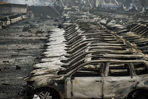 Rows of burnt out Volkswagen cars after a series of explosions at a chemical warehouse in Tianjin on Aug 14.