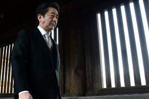 Japanese PM Shinzo Abe visiting the controversial Yasukuni war shrine in Tokyo on Dec 26, 2013.