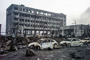 Burnt out Volkswagen cars are pictured on the second morning after a series of explosions at a chemical warehouse hit the city of Tianjin, China on Aug 14, 2015.