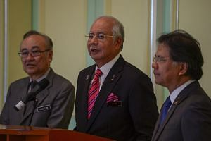 Malaysia's Prime Minister Najib Razak (centre) during a press conference at the premiers' office in Putrajaya on Aug 14, 2015.