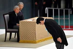 Prime Minister Shinzo Abe bowing before an altar yesterday, during an annual memorial service for war victims in Tokyo, as Emperor Akihito and Empress Michiko looked on.