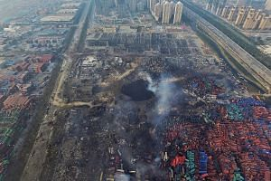 An aerial view of a large hole in the ground in the aftermath of a huge explosion that rocked the port city of Tianjin, China, on Aug 15, 2015.