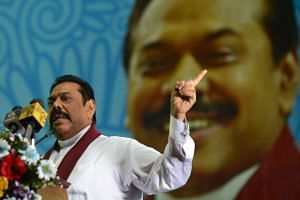 Former Sri Lankan president and parliamentary candidate Mahinda Rajapakse gestures during a speech at a rally in Gampaha on Aug 14, 2015.