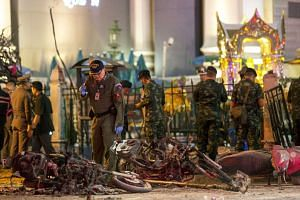 Experts investigating the site of a blast in central Bangkok on Aug 17.