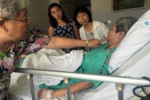 [ ]Mr Ng Su Teck, whose wife Melisa Liu Rui Chun was killed in the blast, in hospital in Bangkok. The Straits Times understands he has been discharged and was due to return to Singapore last night. Ms Betty Ong (left) showing how her sister Jane's fa