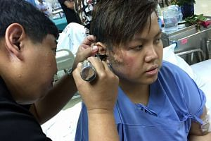 Mr Donovan Chan getting treatment at Chulalongkorn Hospital on Aug 18, 2015. Mr Chan and his mother were brought back to Singapore on Thursday to seek medical care.