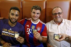 (From left) Americans Anthony Sadler and Alex Skarlatos with Briton Chris Norman, who received medals for bravery.