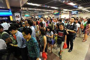 The crowd at City Hall MRT station during a train disruption on July 7, 2015.