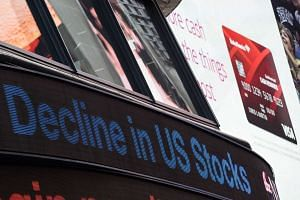 A news ticker in Times Square heralds a headline about the falling stock market on Aug 21, 2015, in New York City.