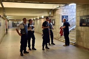 French police standing inside the main train station in Arras, northern France, on Aug 21, 2015.