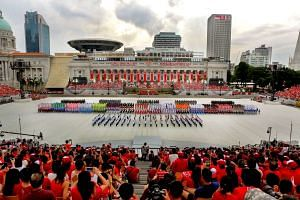 Singaporeans watching the marching contingents form up during the National Day Parade on Aug 9, 2015, during Singapore's Golden Jubilee celebrations.