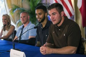 US Ambassador to France Jane Hartley (left to right), US serviceman Spencer Stone, US student Anthony Sadler and US serviceman Alek Skarlatos attend a press conference at the US embassy in Paris, France on Sunday.