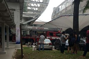Three security officers suffered from smoke inhalation and were taken to National University Hospital.