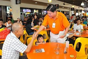 Mr Sebastian Teo greeting a resident at a walkabout in Tampines on July 26.
