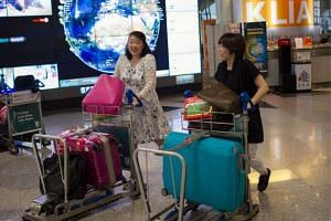 Travellers at KLIA International Airport in Malaysia.