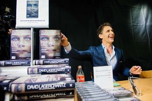 Swedish author David Lagercrantz signing copies of The Girl In The Spider's Web on Aug 27 at a bookstore in Stockholm.